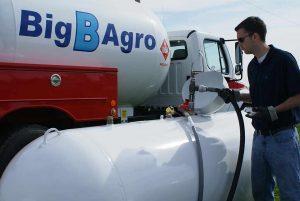 Service technician filling propane tank